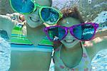 Two Girls Wearing Giant Sunglasses Underwater
