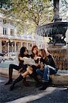 Women Looking at Map by Fountain, Paris, France    Stock Photo - Premium Rights-Managed, Artist: Mark Leibowitz, Code: 700-00650012