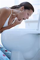 Woman Inducing Vomiting    Stock Photo - Premium Rights-Managednull, Code: 700-00661134