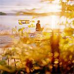 Woman Sitting on Dock At Sunset    Stock Photo - Premium Rights-Managed, Artist: Derek Shapton, Code: 700-00661291