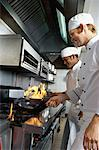 side profile of two chefs cooking food in the kitchen Stock Photo - Premium Royalty-Free, Artist: Ron Fehling, Code: 618-00664655