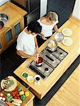 high angle view of a young couple cooking food in the kitchen Stock Photo - Premium Royalty-Free, Artist: Ron Fehling, Code: 618-00664680