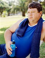 mid adult man holding a water bottle in a park Stock Photo - Premium Royalty-Freenull, Code: 618-00669185