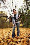 Woman Raking Leaves    Stock Photo - Premium Rights-Managed, Artist: Ken Davies, Code: 700-00678997