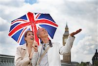 Tourists With Union Jack Umbrella Checking For Rain, London, England    Stock Photo - Premium Rights-Managednull, Code: 700-00680920