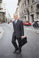 Businessman Crossing Street    Stock Photo - Premium Rights-Managednull, Code: 700-00680925