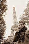 Man Using Cell Phone by Eiffel Tower, Paris, France    Stock Photo - Premium Rights-Managed, Artist: Leanne Pedersen, Code: 700-00681010
