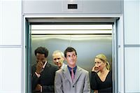 sweaty businessman - Business People on Elevator Smelling Unpleasant Odor    Stock Photo - Premium Rights-Managednull, Code: 700-00681396