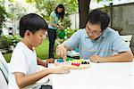 Father Playing Chinese Checkers with Son    Stock Photo - Premium Rights-Managed, Artist: Masterfile, Code: 700-00686882