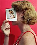 Young Woman Covering Profile With Self-Portrait Stock Photo - Premium Royalty-Free, Artist: Jerzyworks, Code: 621-00687562