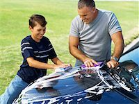 high angle view of a father and his son washing a car Stock Photo - Premium Royalty-Freenull, Code: 618-00689887