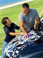 high angle view of a father and his son washing a car Stock Photo - Premium Royalty-Freenull, Code: 618-00689888