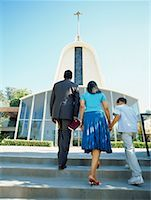 rear view of parents and their son walking up the steps Stock Photo - Premium Royalty-Freenull, Code: 618-00690089