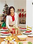 portrait of a mid adult woman laying a dining table Stock Photo - Premium Royalty-Freenull, Code: 618-00693556