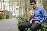 Businessman Eating, Bryant Park, New York, New York, USA