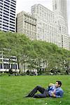 Businessman Lying on Grass, Bryant Park, New York, New York, USA