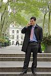 Businessman Using Cellular Telephone, Bryant Park, New York, New York, USA