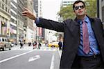 Businessman Hailing a Cab, New York, New York, USA