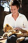 Man Petting Lion Cub    Stock Photo - Premium Rights-Managed, Artist: Mark Leibowitz, Code: 700-00695857