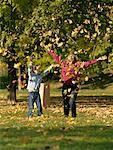 Woman and Girl Throwing Leaves    Stock Photo - Premium Rights-Managed, Artist: Matthew Plexman, Code: 700-00695875