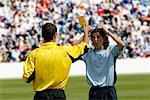 Referee showing yellow card to disappointed player Stock Photo - Premium Royalty-Freenull, Code: 622-00701502