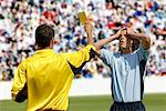 Referee showing yellow card to disappointed player Stock Photo - Premium Royalty-Freenull, Code: 622-00701503