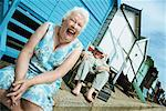 Laughing Senior Couple Sitting in Front of Beach Hut Stock Photo - Premium Royalty-Free, Artist: Puzant Apkarian, Code: 613-00707703