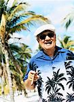 Portrait of a Smiling Senior Man Wearing a Hawaiian Shirt and Smoking a Cigar Stock Photo - Premium Royalty-Free, Artist: Cusp and Flirt, Code: 613-00710157