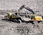 Digger and Dump Truck Stock Photo - Premium Royalty-Freenull, Code: 621-00739924