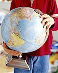 Boy Holding Globe Stock Photo - Premium Royalty-Free, Artist: Scott Tysick, Code: 621-00740548