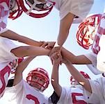 Football Team Huddle Stock Photo - Premium Royalty-Free, Artist: Masterfile, Code: 621-00745519