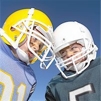 Pee Wee Leaguers Butting Heads Stock Photo - Premium Royalty-Freenull, Code: 621-00745556