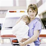 Nurse Holding Little Girl Stock Photo - Premium Royalty-Free, Artist: Graham French, Code: 621-00745623