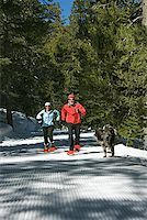 Couple cross-country skiing with dog Stock Photo - Premium Royalty-Freenull, Code: 604-00753725