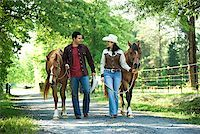 Couple with horses Stock Photo - Premium Royalty-Freenull, Code: 604-00754343