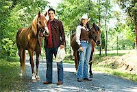 Couple with horses Stock Photo - Premium Royalty-Freenull, Code: 604-00754344