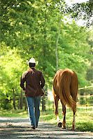 Man with horse Stock Photo - Premium Royalty-Freenull, Code: 604-00754345