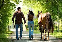 Couple with horse holding hands Stock Photo - Premium Royalty-Freenull, Code: 604-00754351