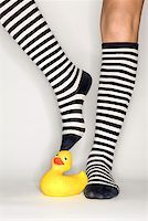 stocking feet - Striped socks with rubber duck Stock Photo - Premium Royalty-Freenull, Code: 604-00757590