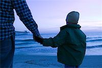 pre-teen boy models - Parent and child holding hands at beach Stock Photo - Premium Royalty