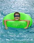 Boy in pool Stock Photo - Premium Royalty-Free, Artist: Tim Mantoani, Code: 604-00761468