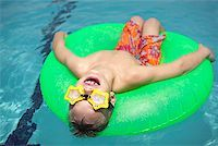 Boy in pool Stock Photo - Premium Royalty-Freenull, Code: 604-00761471