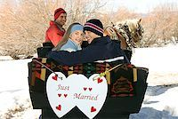 Couple in horse drawn sleigh with just married sign Stock Photo - Premium Royalty-Freenull, Code: 604-00762175