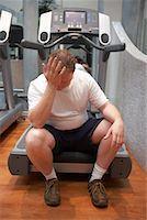 fat man exercising - Man Sitting on Treadmill    Stock Photo - Premium Rights-Managednull, Code: 700-00767945