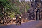 Man Riding Elephant At Gateway to Angkor Thom, Cambodia