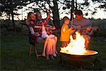 Family Roasting Marshmallows    Stock Photo - Premium Rights-Managed, Artist: Jerzyworks, Code: 700-00768235