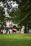 Woman Pushing Baby in Stroller    Stock Photo - Premium Rights-Managed, Artist: Jerzyworks, Code: 700-00768353