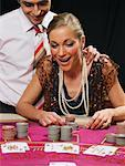Woman Playing Cards, Man Standing Behind Her    Stock Photo - Premium Rights-Managed, Artist: Masterfile, Code: 700-00768653