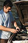 Man Working on Vehicle    Stock Photo - Premium Rights-Managed, Artist: Dazzo, Code: 700-00782313