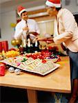 Young man and mature woman eating at a party Stock Photo - Premium Royalty-Free, Artist: Marie Blum, Code: 618-00785077